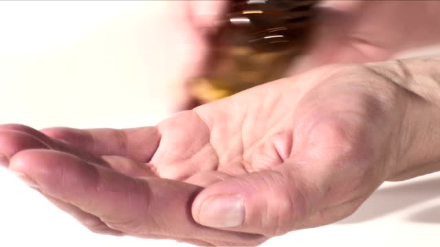 Woman pour pills into hand - Slow Motion HD video