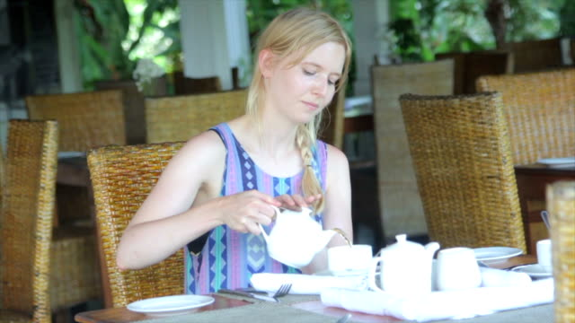Woman Pouring Tea in a Cafe video