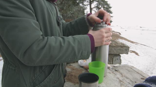 Woman pours hot tea video