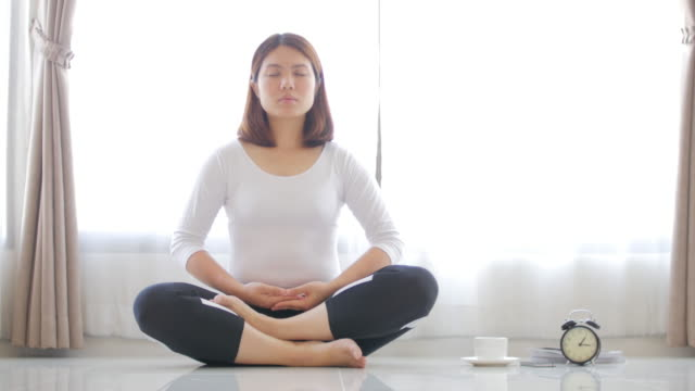 Woman practice Yoga with black coffee at Home 4K(UHD) : Woman practice Yoga with black coffee at Home , Dolly shot , Apple ProRes 422 (HQ) , 3840x2160 format lotus position stock videos & royalty-free footage
