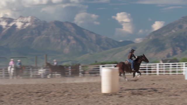 woman practicing barrel racing - cowgirl video stock e b–roll