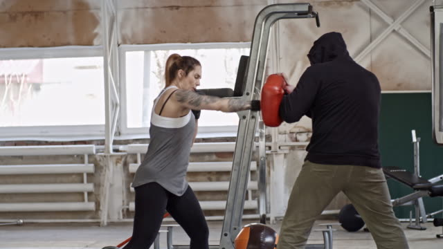Woman Practicing Boxing with Instructor video