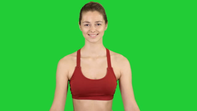 woman practicing yoga meditation smiling on a green screen, chroma key - mudra video stock e b–roll