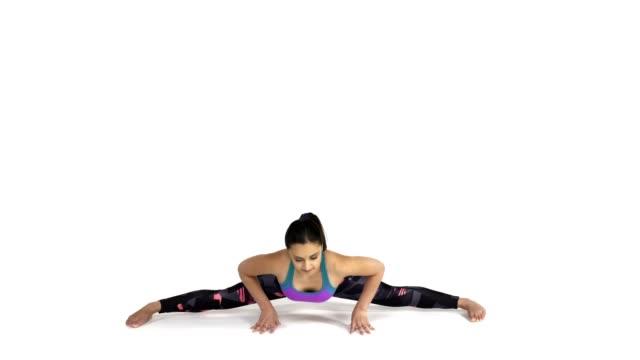 Woman practicing yoga Samakonasana, Splits Pose video