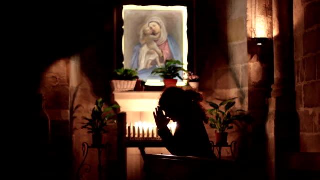 Woman praying in church video