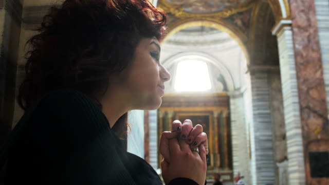 woman praying inside a church video