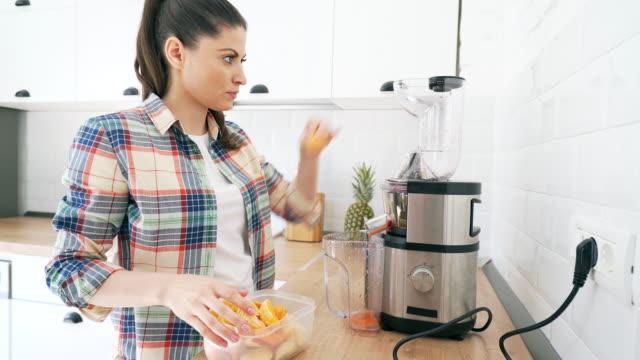 Woman preparing a healthy smoothie. video