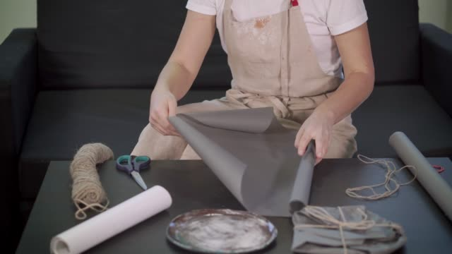 Woman preparing a present in her workshop