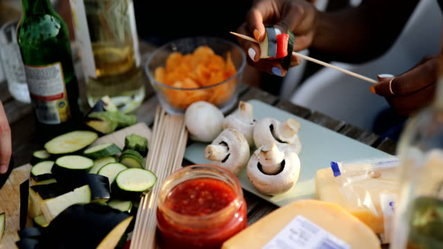 woman preparing food on skewer for barbecue - melanzane video stock e b–roll