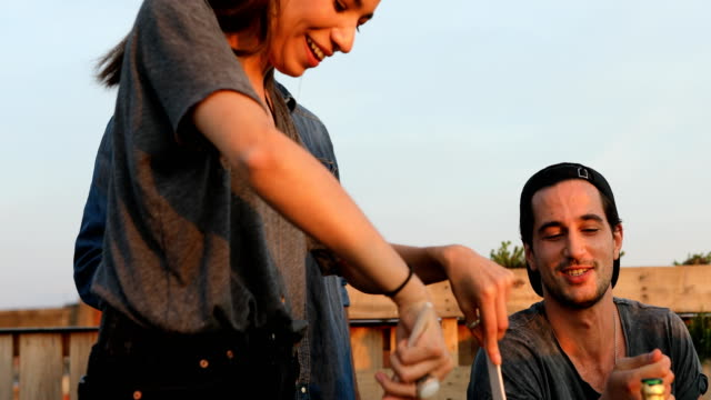woman preparing pasta by men at building terrace - terrazza video stock e b–roll
