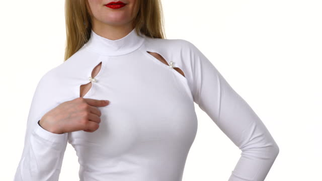 Woman presenting white long sleeve neck top Unrecognizable woman wearing fashionable clothing white long sleeve neck top decorated with pearls, isolated. Fashion concept. sleeve stock videos & royalty-free footage