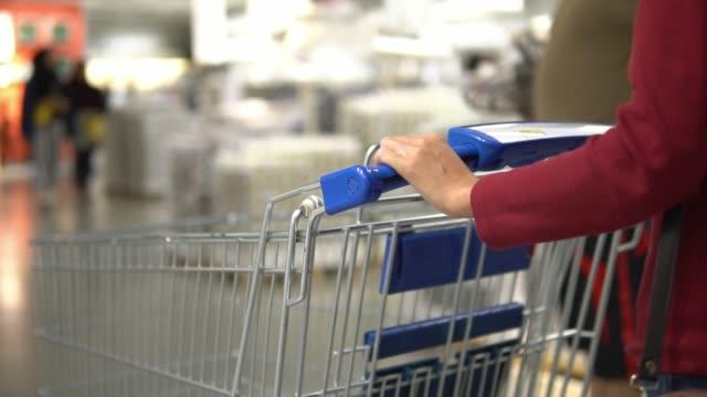 Woman pushing shopping cart Woman pushing shopping cart woman pushing cart stock videos & royalty-free footage