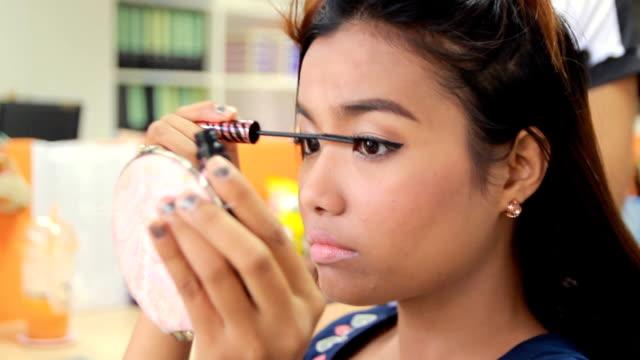 Woman putting on mascara Woman putting on mascara mascara stock videos & royalty-free footage