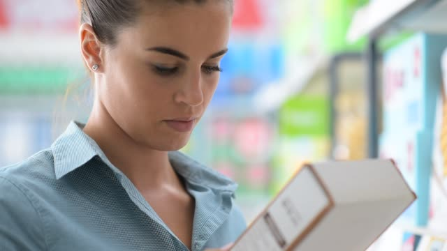 Woman reading a product label