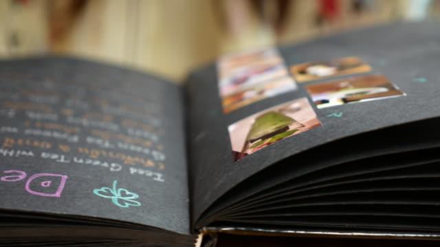Woman reading menu for order in restauran Woman reading menu for order in restauran menu stock videos & royalty-free footage