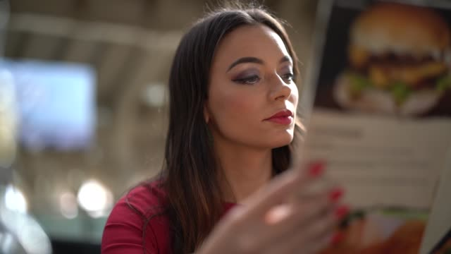 Woman Reading Menu Restaurante Scene menu stock videos & royalty-free footage