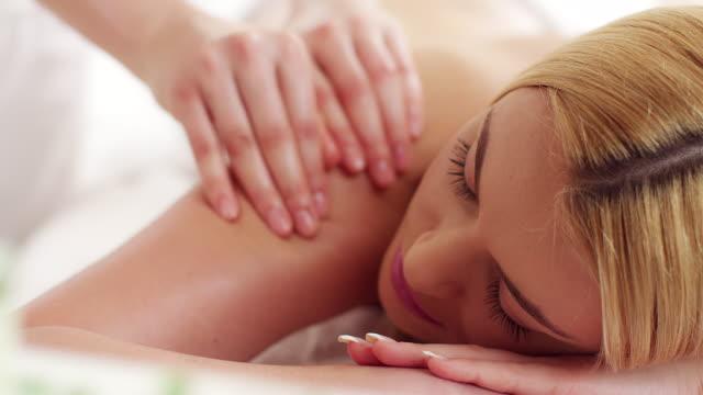 Woman receiving back massage video