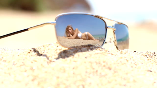 woman reflected in sunglasses video