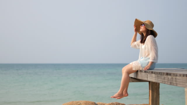 Woman Relaxing at sea with Blue sky , relaxation concept , 4k(UHD) video