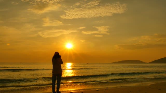 Woman Relaxing at Sunset Beach video