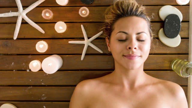 Woman relaxing at the spa Beautiful woman relaxing at the spa - beauty concepts spa treatment stock videos & royalty-free footage
