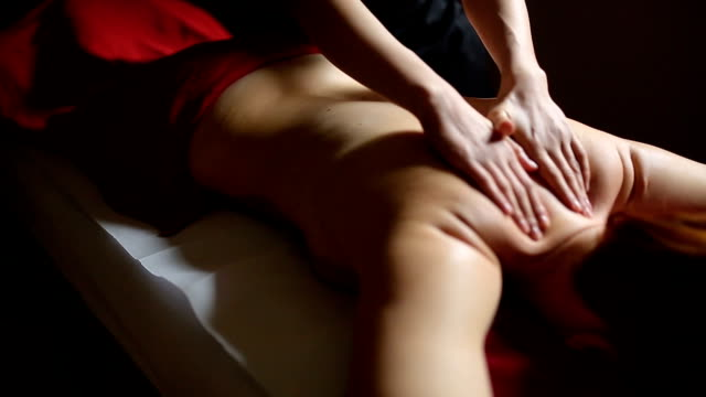 Woman relaxing during massage at the spa Woman relaxing during massage at the spa massage oil stock videos & royalty-free footage