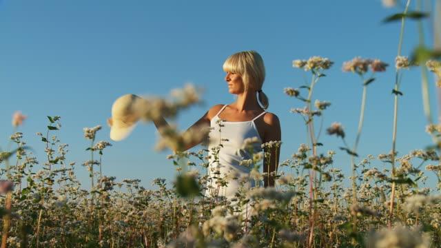 HD DOLLY: Woman Relaxing In A Field video