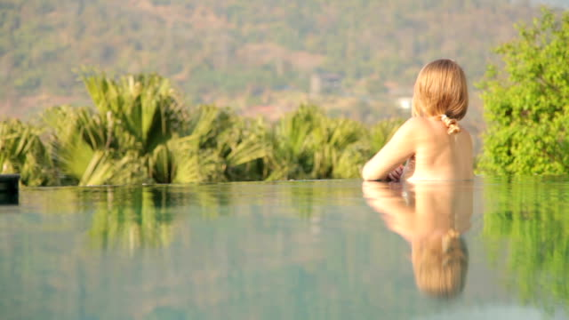 Woman Relaxing in Private Swimming Pool on Vacation video