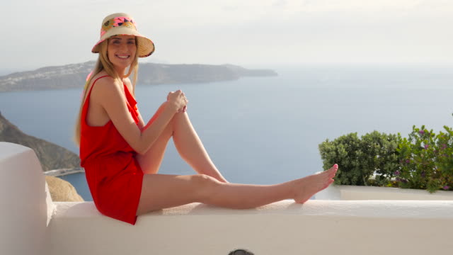 Woman relaxing in Santorini video