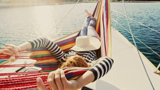 ws woman relaxing on a sailboat - affluent lifestyles stock videos & royalty-free footage