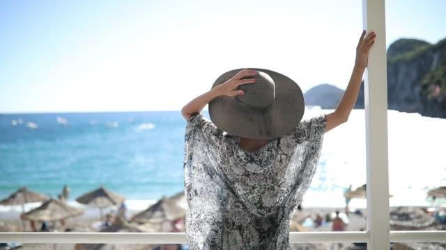 kvinna avkopplande semester - grekland bildbanksvideor och videomaterial från bakom kulisserna