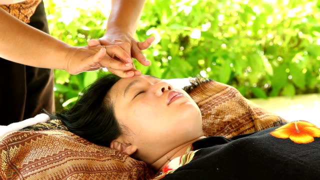 Woman Relaxing While Getting face Massage Woman Relaxing While Getting face Massage, High Definition 1920x1080 Format massage oil stock videos & royalty-free footage