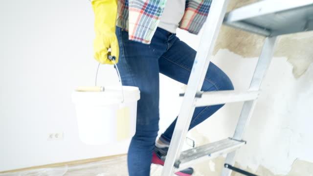 Woman repairing a broken wall. video