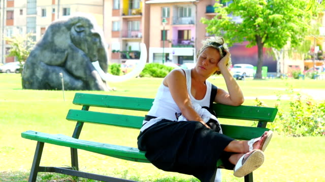 Woman resting in park video
