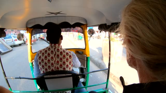 woman rides in tuk-tuk rickshaw with driver - india video stock e b–roll