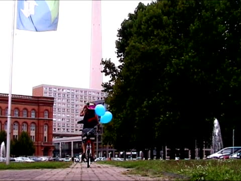Woman riding bike in the city video