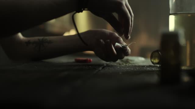 Woman rolling marijuana joint video