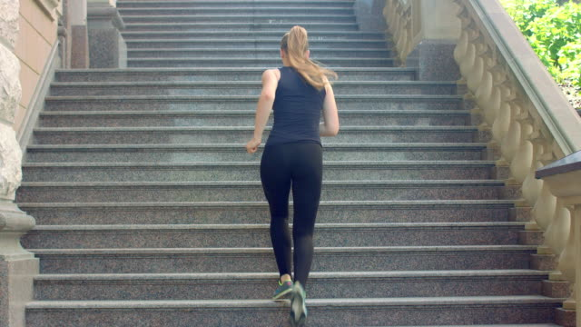 woman run up stairs in slow motion. weight loss exercise - staircases stock videos & royalty-free footage