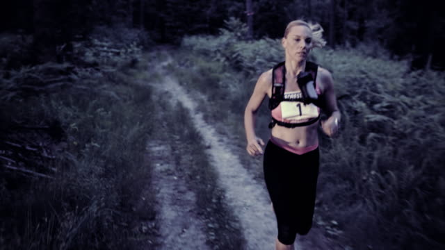SLO MO DS Woman running a trail marathon at sunset video