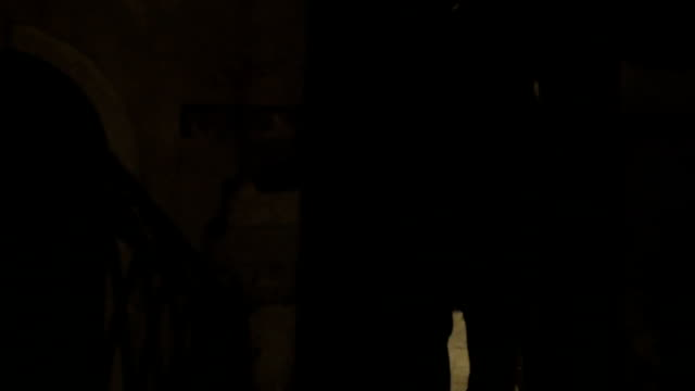 Woman running in dark alleyway at night Steadicam shot of a woman with phone running at night. She escaping from maniac in dark narrow passage between old worn buildings alley stock videos & royalty-free footage
