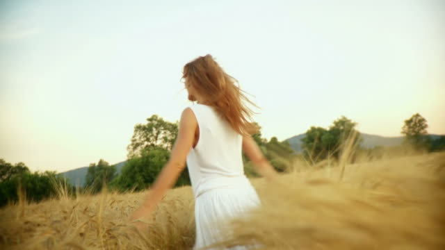 HD SLOW-MOTION: Woman Running In Wheat video