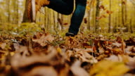 istock MS Woman running through autumn leaves in idyllic forest 1201413972