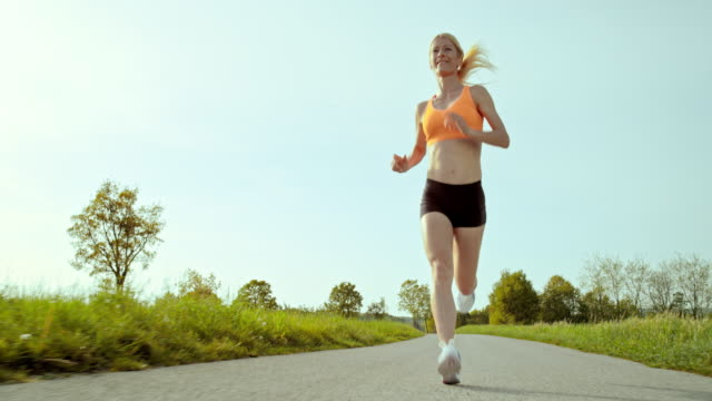 SLO MO TS Woman running through countryside video