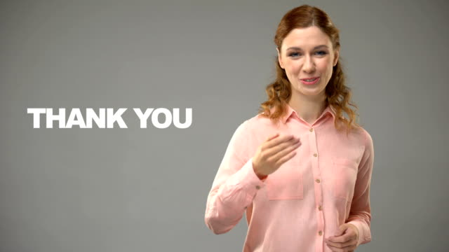 Woman saying thank you in sign language, text on background, communication