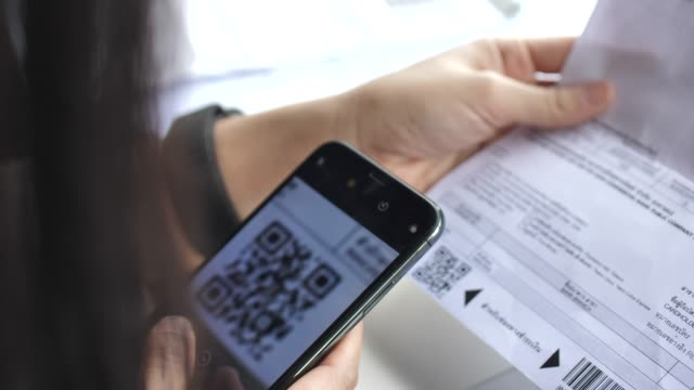woman scan qr code for bill payment with mobile phone - digital mobile consumption video stock e b–roll