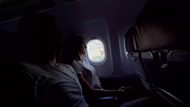 Woman scared of flying, man holding hand