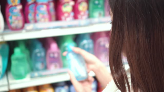 Woman selects product on the shelves in the store video