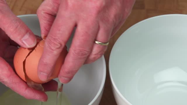 Woman Separating Organic Egg Close-up (4:2:2@100 Mb/s) video