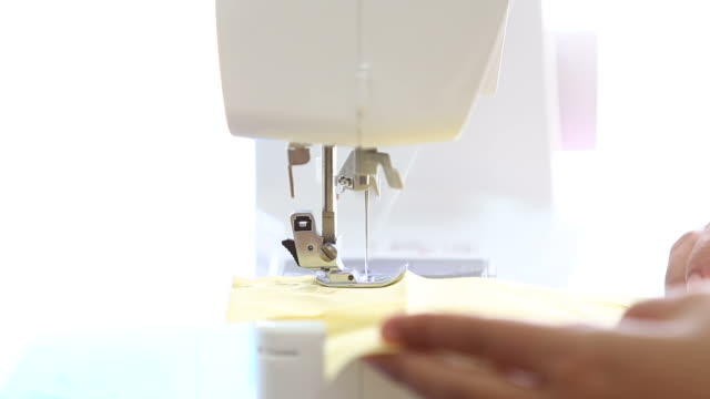Woman sewing working video