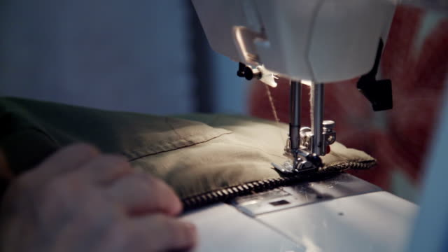 Woman sews on the sewing machine video